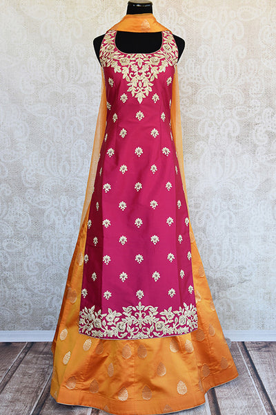 Buy Pink and yellow banarasi silk skirt-kurta with full heavy embroidery and buta comes with dupatta. Ideal for wedding parties.-Full view