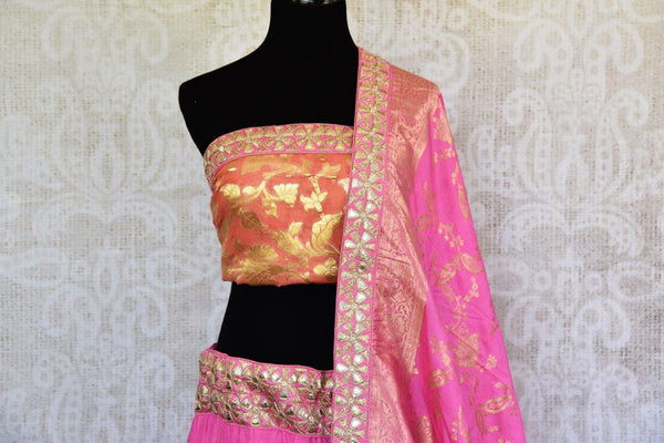 Buy pink and orange Banarasi silk Lehenga with blouse piece and dupatta online in USA.  Pure Elegance store brings exquisite range of Indian dresses online in USA.-top