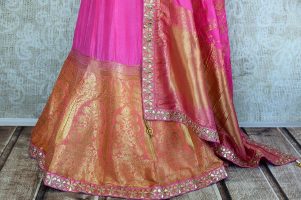 Buy pink and orange Banarasi silk Lehenga with blouse piece and dupatta online in USA.  Pure Elegance store brings exquisite range of Indian dresses online in USA.-lehenga
