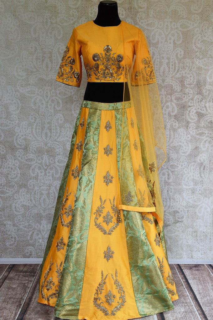 Buy online designer yellow silk and Banarasi embroidered lehenga with blouse and dupatta .  Pure Elegance store brings traditional Indian dresses online in USA.-full view
