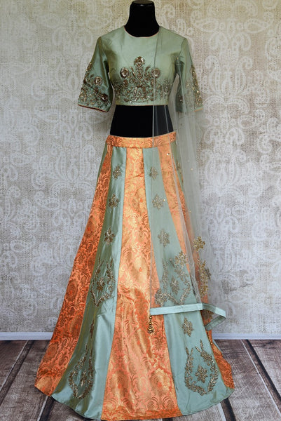 Buy online designer grey silk and Banarasi embroidered lehenga with blouse and dupatta .  Pure Elegance store brings beautiful Indian dresses online in USA.-full view