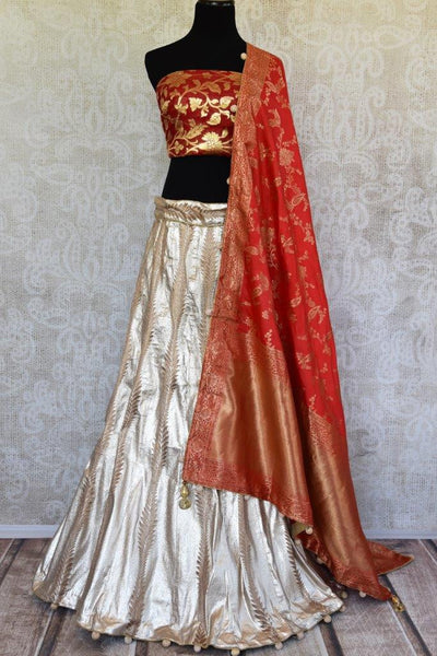 Buy gold Banarasi silk Lehenga with red blouse piece and dupatta online in USA.  Pure Elegance store brings exquisite range of Indian designer lehenga online in USA.-full view