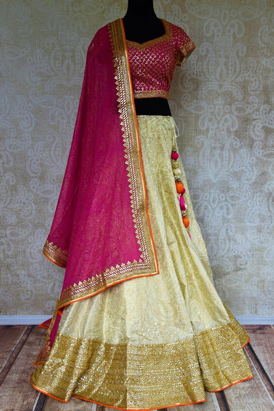Buy pink and cream embroidered lehenga choli online from Pure Elegance with dupatta. Our Indian fashion store brings stunning desginer wedding lehengas in USA.-full view