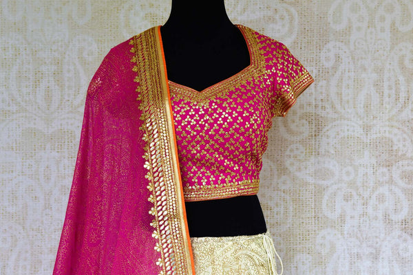 Buy pink and cream embroidered lehenga choli online from Pure Elegance with dupatta. Our Indian fashion store brings stunning desginer wedding lehengas in USA.-choli front