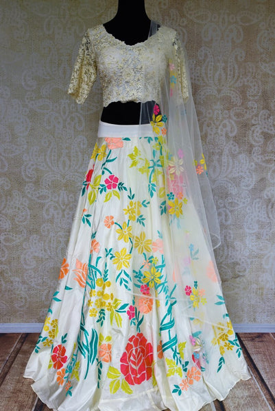 Buy white embroidered silk lehenga choli online from Pure Elegance with dupatta. Our fashion store brings stunning Indian designer lehenga choli in USA for women.-full view