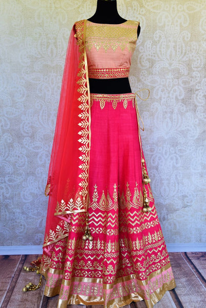 Buy pink applique work raw silk lehenga with dupatta online in USA. Pure Elegance fashion store brings a stunning range of Indian lehenga dresses in USA for weddings.-full view