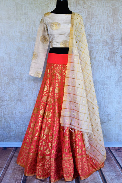 Buy offwhite and orange Banarasi lehenga with dupatta online in USA. Pure Elegance fashion store brings a stunning range of Indian designer lehengas in USA for weddings.-full view