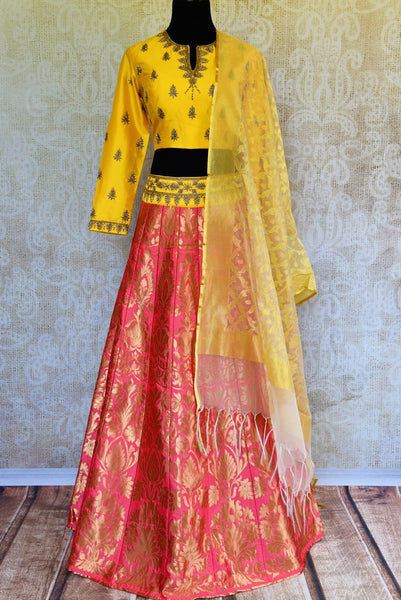 Buy yellow and pink silk lehenga online in usa with zardozi work. Pure Elegance fashion store brings an exquisite range of Indian designer lehengas in USA for women.-full view