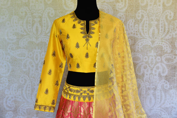 Buy yellow and pink silk lehenga online in usa with zardozi work. Pure Elegance fashion store brings an exquisite range of Indian designer lehengas in USA for women.-blouse