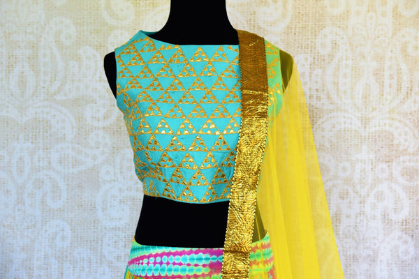 Buy blue gota patti silk blouse online in usa with multicolor skirt. Pure Elegance fashion store brings an exquisite range of Indian designer lehenga choli in USA.-blouse