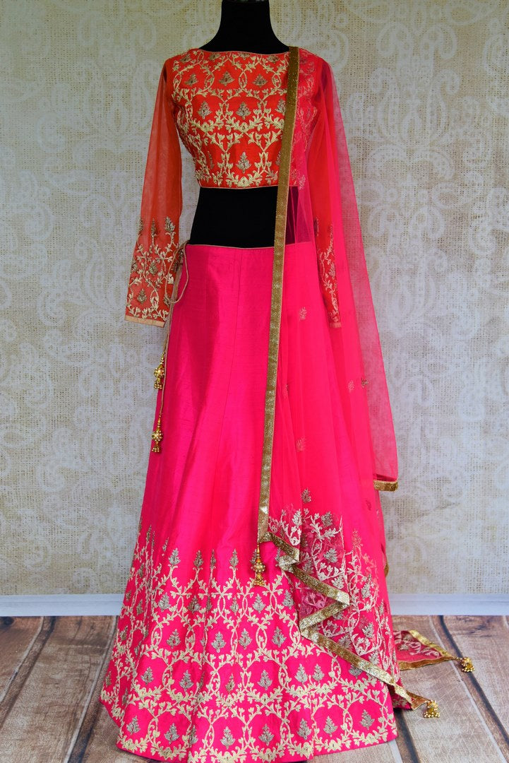 Buy pink and orange embroidered silk lehenga online in USA. Pure Elegance fashion store brings a stunning range of Indian designer lehenga choli in USA for weddings.-full view
