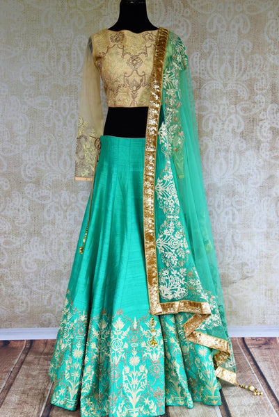 Buy green and cream embroidered silk lehenga online in USA. Pure Elegance fashion store brings a stunning range of Indian designer lehenga skirt in USA for women.-full view