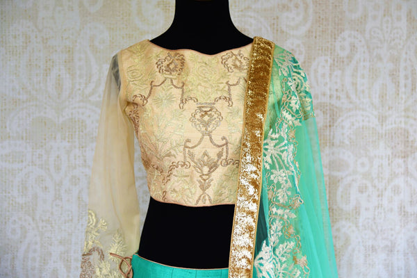 Buy green and cream embroidered silk lehenga online in USA. Pure Elegance fashion store brings a stunning range of Indian designer lehenga skirt in USA for women.-blouse