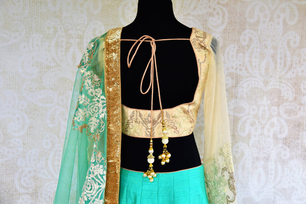 Buy green and cream embroidered silk lehenga online in USA. Pure Elegance fashion store brings a stunning range of Indian designer lehenga skirt in USA for women.-blouse back