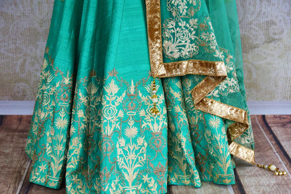 Buy green and cream embroidered silk lehenga online in USA. Pure Elegance fashion store brings a stunning range of Indian designer lehenga skirt in USA for women.-skirt