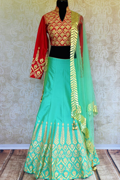 Buy red and green applique work silk lehenga online in USA. Pure Elegance fashion store brings a stunning range of Indian designer lehenga dresses in USA for weddings.-full view