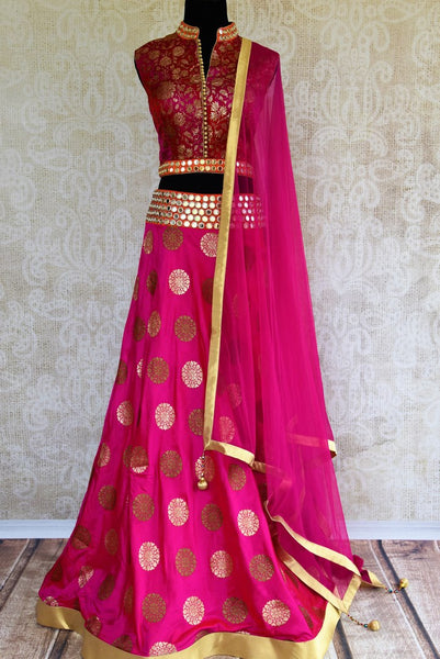 Buy pink mirror work Banarasi lehenga with dupatta online in USA. Pure Elegance clothing store brings an exquisite range of Indian designer lehengas in USA. Shop online.-full view