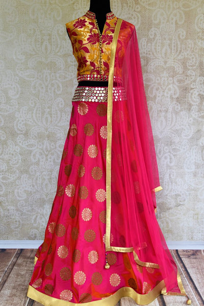 Buy bright pink mirror work Banarasi lehenga with dupatta online in USA. Pure Elegance clothing store brings an exquisite range of Indian designer dresses in USA. -full view