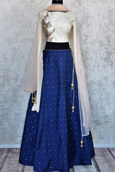 Buy white & blue embroidered chanderi silk skirt blouse online in USA. Choose from an exquisite range of Indian designer dresses at Pure Elegance online store or visit our store in USA.-full view
