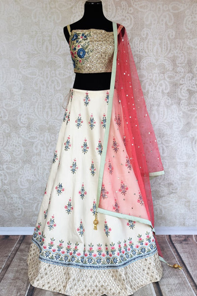 Buy beautiful off-white embroidered lehenga choli set online in USA. The elegant attire is a perfect pick for an Indo-western look at wedding and parties. Get floored by an exclusive collection of Indian designer lehengas in USA available at Pure Elegance fashion store or shop online.-full view