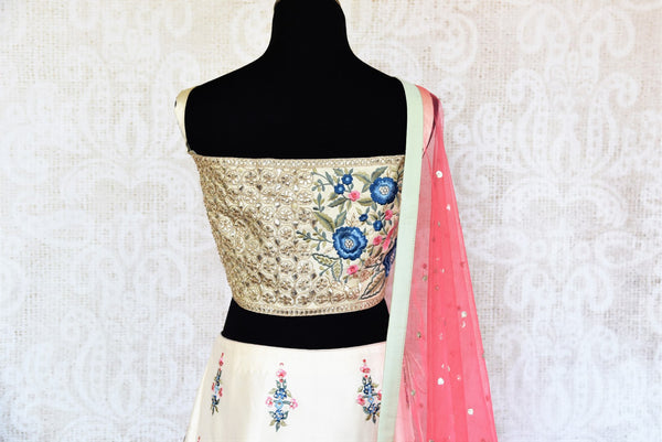 Buy beautiful off-white embroidered lehenga choli set online in USA. The elegant attire is a perfect pick for an Indo-western look at wedding and parties. Get floored by an exclusive collection of Indian designer lehengas in USA available at Pure Elegance fashion store or shop online.-back