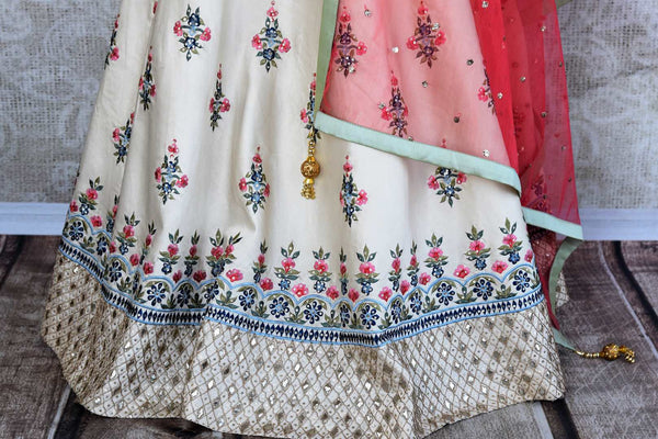 Buy beautiful off-white embroidered lehenga choli set online in USA. The elegant attire is a perfect pick for an Indo-western look at wedding and parties. Get floored by an exclusive collection of Indian designer lehengas in USA available at Pure Elegance fashion store or shop online.-skirt
