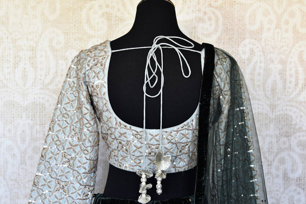 Buy black embroidered velvet lehenga online in USA with dupatta. The lehenga is perfect for rich Indian ethnic look at weddings. Make your Indian clothing collection exquisite with beautiful Indian designer lehengas available at Pure Elegance clothing store in USA or shop online.-blouse back
