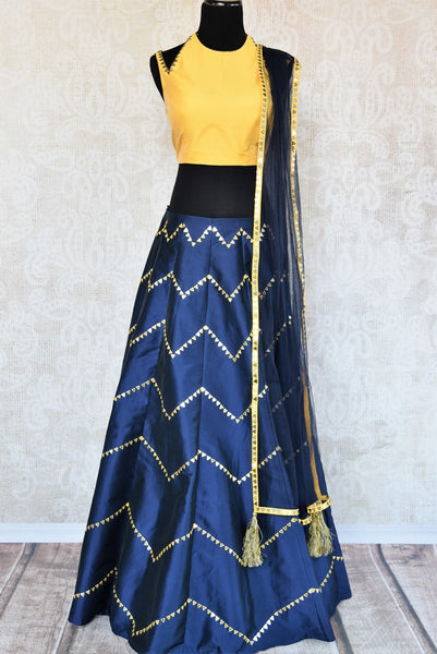 Buy yellow and blue embroidered silk lehenga choli with dupatta online in USA. The modern yet traditional outfit is a stunning choice for parties and special occasions. Get floored by an exclusive collection of Indian wedding lehengas in USA available at Pure Elegance clothing store or shop online.-full view