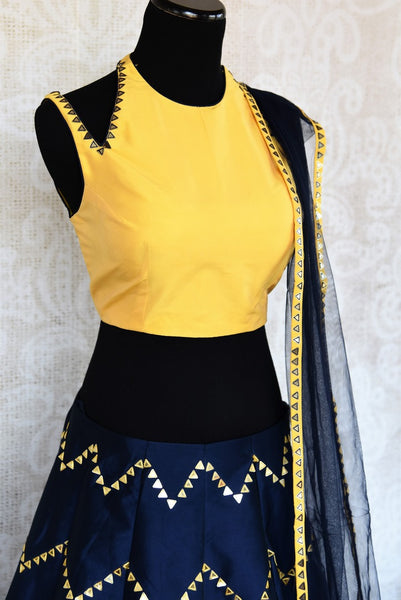 Buy yellow and blue embroidered silk lehenga choli with dupatta online in USA. The modern yet traditional outfit is a stunning choice for parties and special occasions. Get floored by an exclusive collection of Indian wedding lehengas in USA available at Pure Elegance clothing store or shop online.-side view