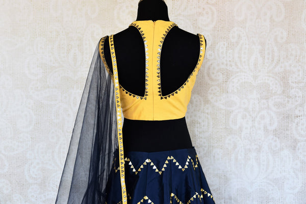 Buy yellow and blue embroidered silk lehenga choli with dupatta online in USA. The modern yet traditional outfit is a stunning choice for parties and special occasions. Get floored by an exclusive collection of Indian wedding lehengas in USA available at Pure Elegance clothing store or shop online.-back