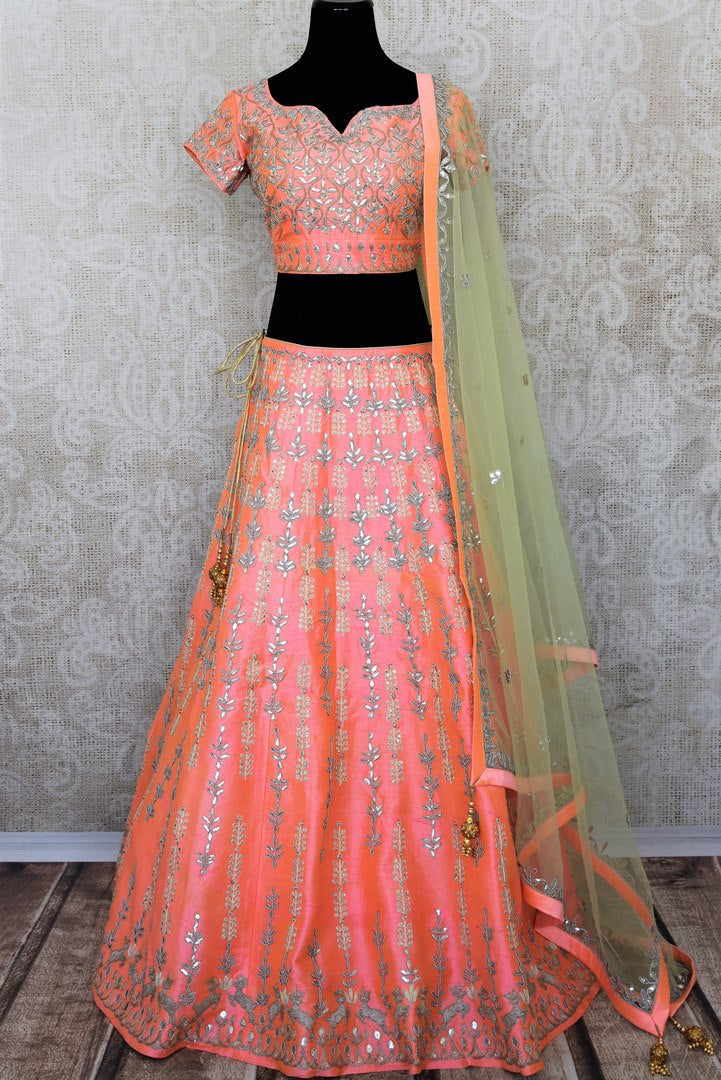 Buy soft pink raw silk gota patti embroidery lehenga with dupatta online in USA. Add brilliance to your Indian wedding look with an exquisite range of designer wedding lehengas available at Pure Elegance exclusive clothing store in USA or shop online.-full view