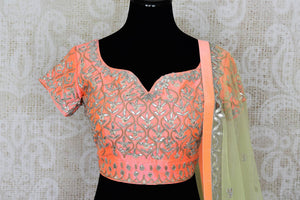 Buy soft pink raw silk gota patti embroidery lehenga with dupatta online in USA. Add brilliance to your Indian wedding look with an exquisite range of designer wedding lehengas available at Pure Elegance exclusive clothing store in USA or shop online.-blouse front