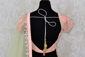 Buy soft pink raw silk gota patti embroidery lehenga with dupatta online in USA. Add brilliance to your Indian wedding look with an exquisite range of designer wedding lehengas available at Pure Elegance exclusive clothing store in USA or shop online.-blouse back