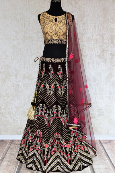 Buy purple embroidered velvet lehenga with dupatta online in USA . The designer lehenga is a captivating choice for weddings. Shop Indian wedding lehengas in USA from an alluring collection available at Pure Elegance clothing store.-full view