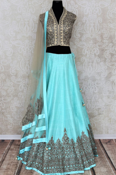 Buy sky blue raw silk zardozi embroidery lehenga with dupatta online in USA. Add brilliance to your Indian wedding look with an exquisite range of designer wedding lehengas available at Pure Elegance exclusive clothing store in USA or shop online.-full view