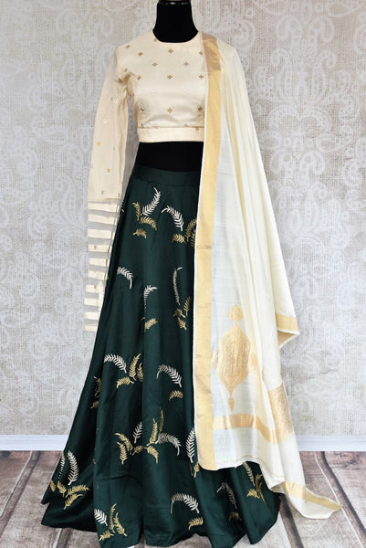 Buy cream and green embroidered silk lehenga choli with dupatta online in USA. The traditional outfit is a stunning choice for parties and special occasions. Get floored by an exclusive collection of Indian wedding lehengas in USA available at Pure Elegance clothing store or shop online.-full view