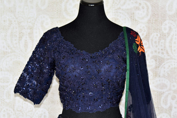 Amaze everyone as you step the aisle in this designer royal blue silk applique work lehenga with a floral blue dupatta. Channel the inner diva as you embrace the embroidered blouse and complete the look with utmost grace and poise. Shop designer Indian dress,Anarkali, lehengas online or visit Pure Elegance store, USA. -blouse front