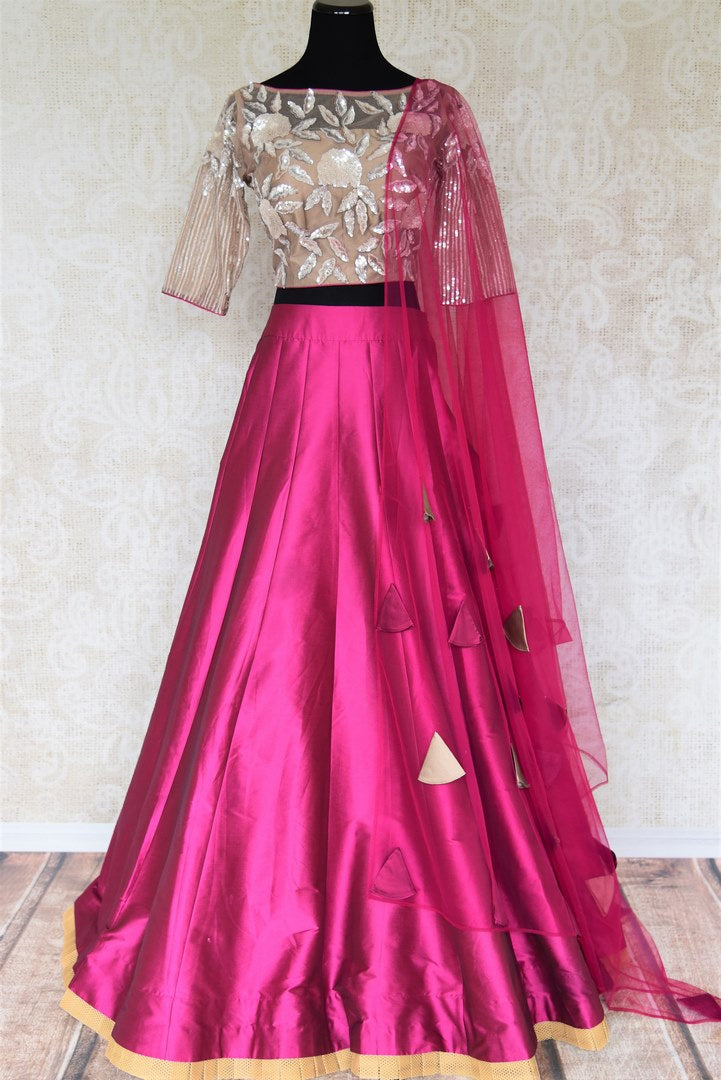 This wedding season, splurge on designer magenta silk net lehenga with a cream embroidered blouse. Drape a purple sheer net dupatta and dress up like an Indian diva. Shop handloom silk dresses, Indian dress online or visit Pure Elegance store in USA. -full view