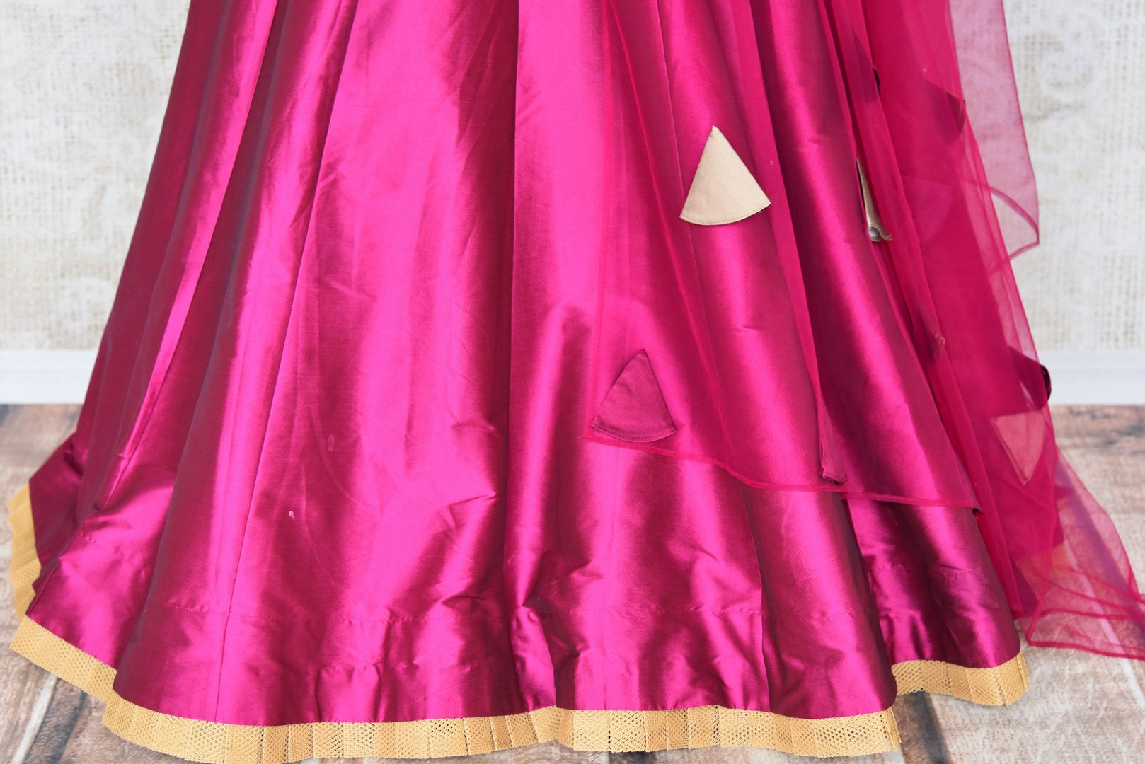 This wedding season, splurge on designer magenta silk net lehenga with a cream embroidered blouse. Drape a purple sheer net dupatta and dress up like an Indian diva. Shop handloom silk dresses, Indian dress online or visit Pure Elegance store in USA. - lehenga skirt