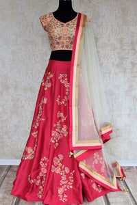 Buy beautiful pink embroidered silk lehenga with dupatta online in USA . The designer lehenga is a captivating choice for weddings. Shop Indian wedding lehengas in USA from an alluring collection available at Pure Elegance clothing store.-full view