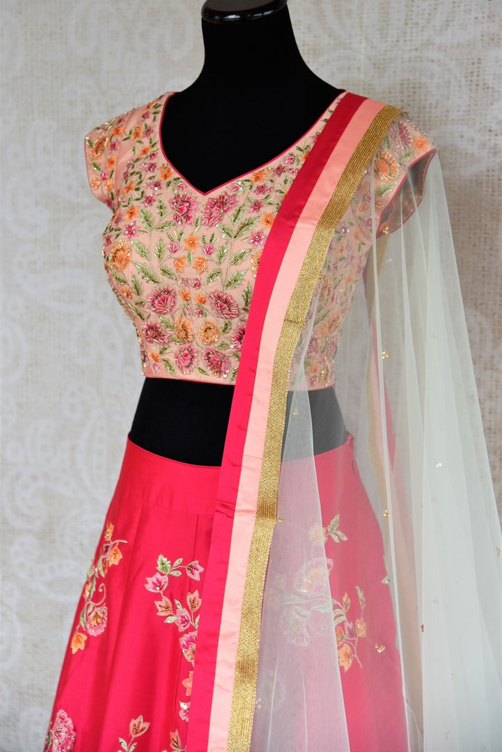 Buy beautiful pink embroidered silk lehenga with dupatta online in USA . The designer lehenga is a captivating choice for weddings. Shop Indian wedding lehengas in USA from an alluring collection available at Pure Elegance clothing store.-side view