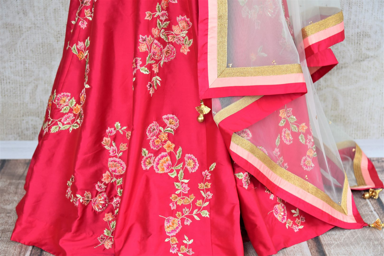 Buy beautiful pink embroidered silk lehenga with dupatta online in USA . The designer lehenga is a captivating choice for weddings. Shop Indian wedding lehengas in USA from an alluring collection available at Pure Elegance clothing store.-skirt