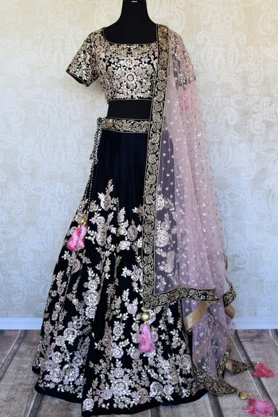 Buy dark blue embroidered velvet lehenga online in USA with pink dupatta. The lehenga is perfect for rich Indian ethnic look at weddings. Make your Indian clothing collection exquisite with beautiful Indian designer wedding lehengas available at Pure Elegance clothing store in USA or shop online.-full view