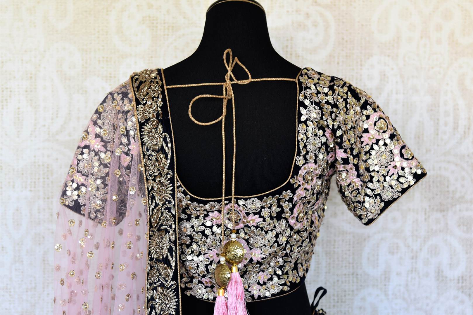 Buy dark blue embroidered velvet lehenga online in USA with pink dupatta. The lehenga is perfect for rich Indian ethnic look at weddings. Make your Indian clothing collection exquisite with beautiful Indian designer wedding lehengas available at Pure Elegance clothing store in USA or shop online.-blouse back