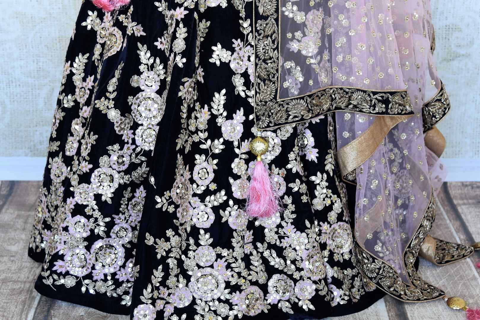 Buy dark blue embroidered velvet lehenga online in USA with pink dupatta. The lehenga is perfect for rich Indian ethnic look at weddings. Make your Indian clothing collection exquisite with beautiful Indian designer wedding lehengas available at Pure Elegance clothing store in USA or shop online.-lehenga skirt