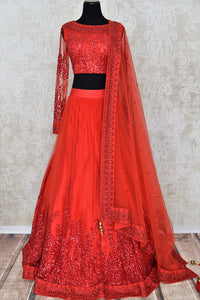 Buy red ticki work designer net lehenga with dupatta online in USA. Add brilliance to your Indian wedding look with an exquisite range of designer wedding lehengas available at Pure Elegance exclusive clothing store in USA or shop online.-full view