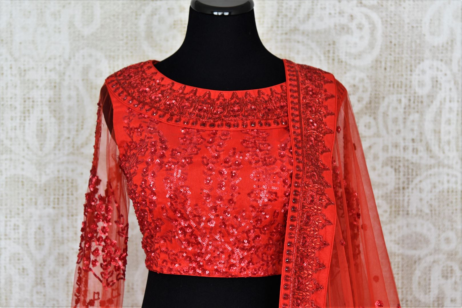 Buy red ticki work designer net lehenga with dupatta online in USA. Add brilliance to your Indian wedding look with an exquisite range of designer wedding lehengas available at Pure Elegance exclusive clothing store in USA or shop online.-blouse front