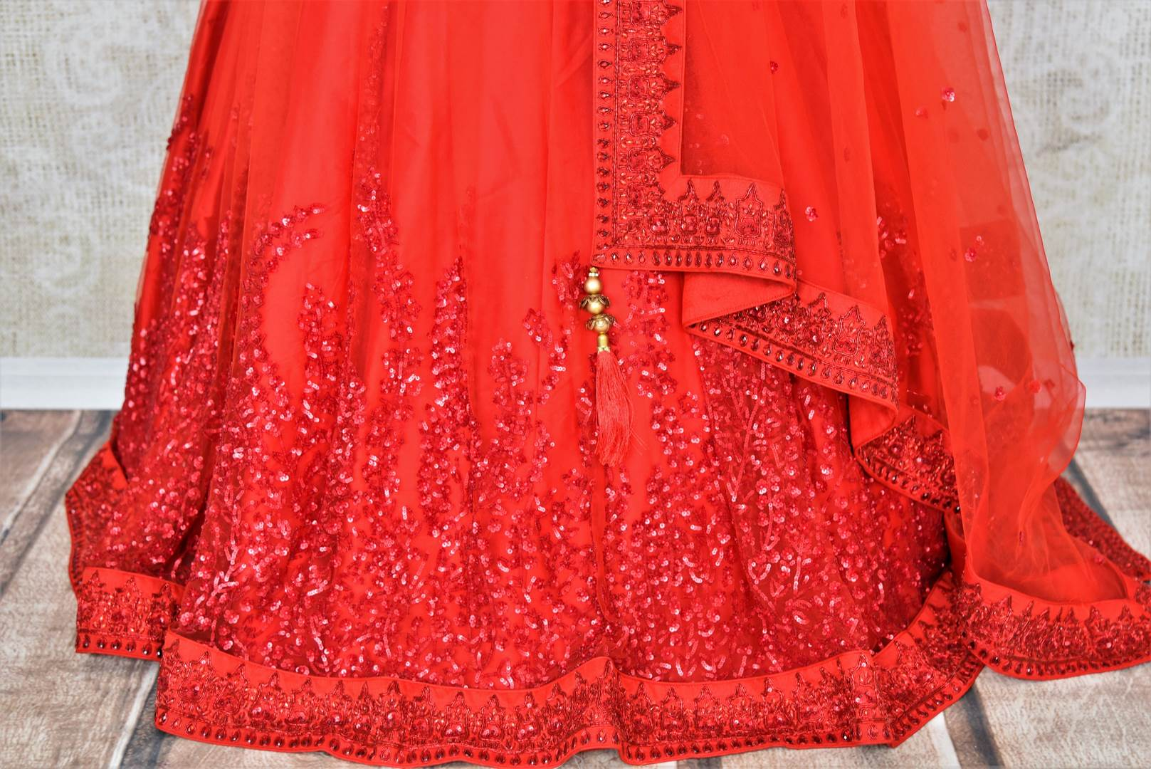 Buy red ticki work designer net lehenga with dupatta online in USA. Add brilliance to your Indian wedding look with an exquisite range of designer wedding lehengas available at Pure Elegance exclusive clothing store in USA or shop online.-skirt