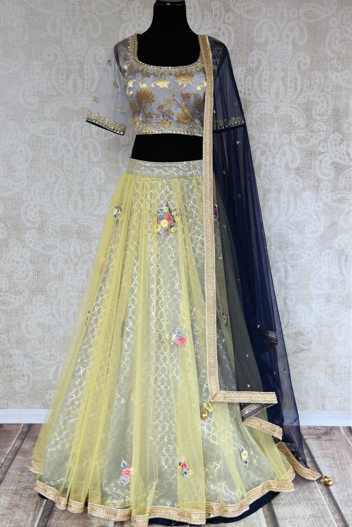 Buy yellow and grey embroidered Banarasi net lehenga with dupatta online in USA . The gorgeous lehenga is a captivating choice for weddings. Shop Indian designer lehengas in USA from an alluring collection available at Pure Elegance clothing store.-full view