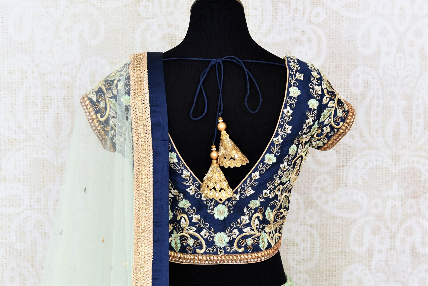Buy pastel green and blue embroidered chanderi lehenga with dupatta online in USA. Add brilliance to your Indian wedding look with an exquisite range of designer wedding lehengas available at Pure Elegance exclusive clothing store in USA or shop online.-blouse back